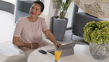 Pregnant lady sitting at table with Laptop