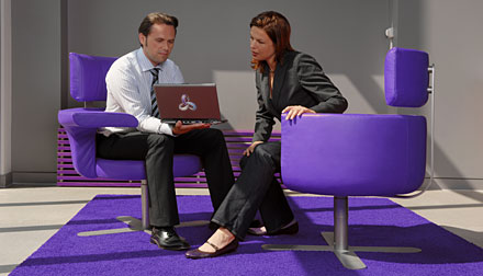 Two business people looking at computer screen